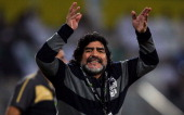 Al Wasl manager Diego Maradona reacts during the Etisalat League match between Al Wasl and Al Shabab at Zabeel Stadium on December 03 2011 in Dubai...