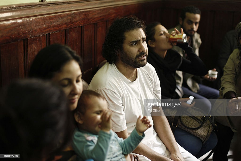Alaa Abdel Fattah, an Egyptian blogger and activist, sits with his family and supporters in a waiting room at Cairo's High Court prior to a hearing on March 26, 2013 in Cairo, Egypt. Five high profile Egyptian activists were summoned by the Egyptian Prosecutor General's office on charges of inciting violent clashes between opposition protesters and supporters of the Muslim Brotherhood in the Cairo suburb of Muqattam on March 22. Those charged include renowned blogger Alaa Abdel Fattah, Popular Current member Ahmed Doma, National Salvation Front member Hazem Abdel-Azim, Constitution Party member Ahmed Eid, activist Karim El-Shaer, and journalist and blogger Nawara Negm.