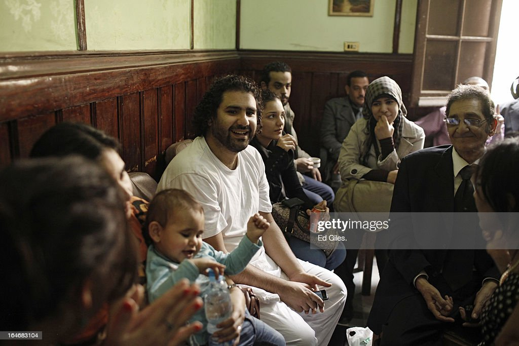 Alaa Abdel Fattah (L), an Egyptian blogger and activist, sits with his family and supporters in a waiting room at Cairo's High Court prior to a hearing on March 26, 2013 in Cairo, Egypt. Five high profile Egyptian activists were summoned by the Egyptian Prosecutor General's office on charges of inciting violent clashes between opposition protesters and supporters of the Muslim Brotherhood in the Cairo suburb of Muqattam on March 22. Those charged include renowned blogger Alaa Abdel Fattah, Popular Current member Ahmed Doma, National Salvation Front member Hazem Abdel-Azim, Constitution Party member Ahmed Eid, activist Karim El-Shaer, and journalist and blogger Nawara Negm.