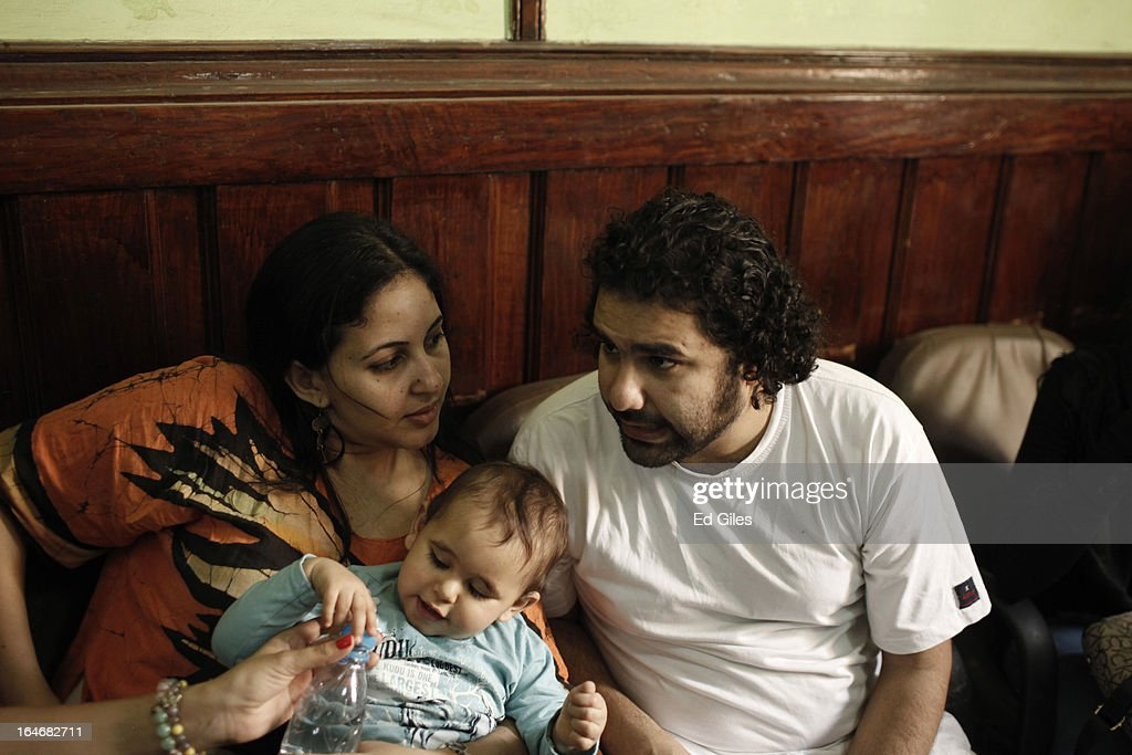 Alaa Abdel Fattah (R), an Egyptian blogger and activist, sits with wife Manal Hassan and their young son in a waiting room at Cairo's High Court prior to a hearing on March 26, 2013 in Cairo, Egypt. Five high profile Egyptian activists were summoned by the Egyptian Prosecutor General's office on charges of inciting violent clashes between opposition protesters and supporters of the Muslim Brotherhood in the Cairo suburb of Muqattam on March 22. Those charged include renowned blogger Alaa Abdel Fattah, Popular Current member Ahmed Doma, National Salvation Front member Hazem Abdel-Azim, Constitution Party member Ahmed Eid, activist Karim El-Shaer, and journalist and blogger Nawara Negm.