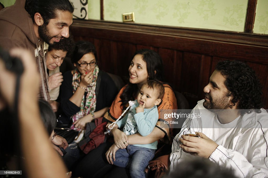Alaa Abdel Fattah (R), an Egyptian blogger and activist, sits with supporters, wife Manal Hassan (2R) and their young son in a waiting room at Cairo's High Court prior to a hearing on March 26, 2013 in Cairo, Egypt. Five high profile Egyptian activists were summoned by the Egyptian Prosecutor General's office on charges of inciting violent clashes between opposition protesters and supporters of the Muslim Brotherhood in the Cairo suburb of Muqattam on March 22. Those charged include renowned blogger Alaa Abdel Fattah, Popular Current member Ahmed Doma, National Salvation Front member Hazem Abdel-Azim, Constitution Party member Ahmed Eid, activist Karim El-Shaer, and journalist and blogger Nawara Negm.