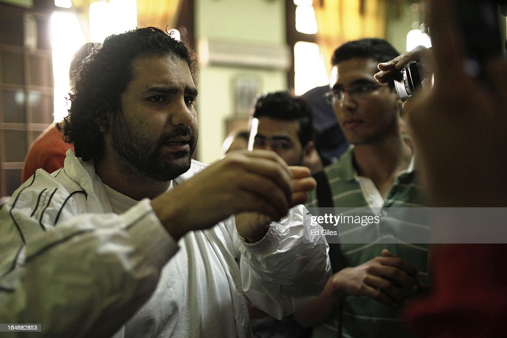 Alaa Abdel Fattah, an Egyptian blogger and activist, speaks with journalists in a waiting room at Cairo's High Court prior to a hearing on March 26, 2013 in Cairo, Egypt. Five high profile Egyptian activists were summoned by the Egyptian Prosecutor General's office on charges of inciting violent clashes between opposition protesters and supporters of the Muslim Brotherhood in the Cairo suburb of Muqattam on March 22. Those charged include renowned blogger Alaa Abdel Fattah, Popular Current member Ahmed Doma, National Salvation Front member Hazem Abdel-Azim, Constitution Party member Ahmed Eid, activist Karim El-Shaer, and journalist and blogger Nawara Negm.