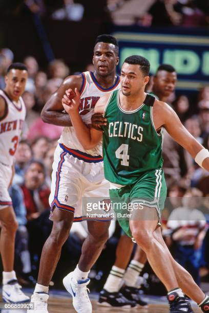 Alaa Abdelnaby of the Boston Celtics battles for position against the New York Knicks during a game played circa 1993 at the Madison Square Garden in...