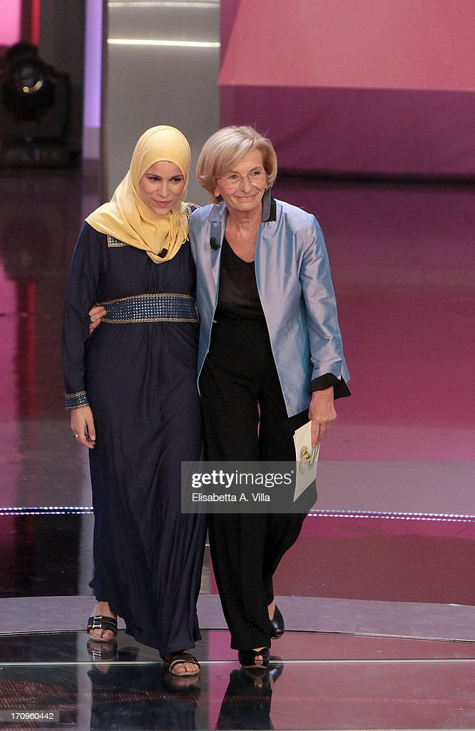 Alaa Murabit (L) and Foreign Minister <a gi-track='captionPersonalityLinkClicked' href=/galleries/search?phrase=Emma+Bonino&family=editorial&specificpeople=539913 ng-click='$event.stopPropagation()'>Emma Bonino</a> attends Premio Bellisario 2013 at Dear RAI studios on June 20, 2013 in Rome, Italy.