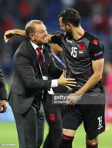 Alabainia's manager Gianni De Bias celebrates with Mergim Mavraj of Albania at full time during the UEFA EURO 2016 Group A match between Romania and...