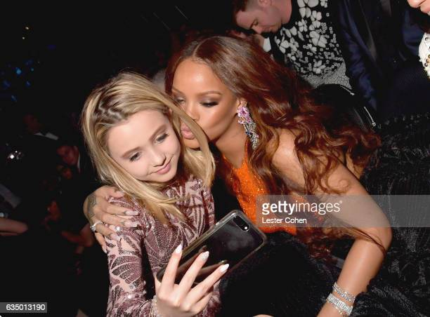 Alabama Barker and singer Rihanna during The 59th GRAMMY Awards at STAPLES Center on February 12 2017 in Los Angeles California