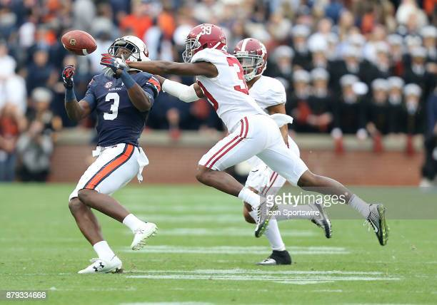 Alabama Crimson Tide defensive back Levi Wallace breaks up a pass intended for Auburn Tigers wide receiver Nate CraigMyers during a football game...