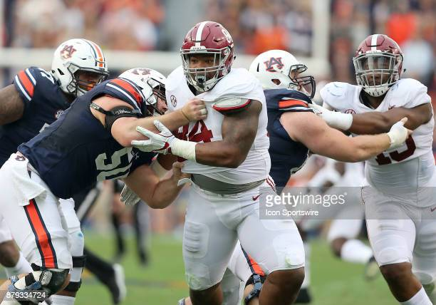 Alabama Crimson Tide defensive lineman Da'Ron Payne fights off the block of Auburn Tigers offensive lineman Casey Dunn during a football game between...