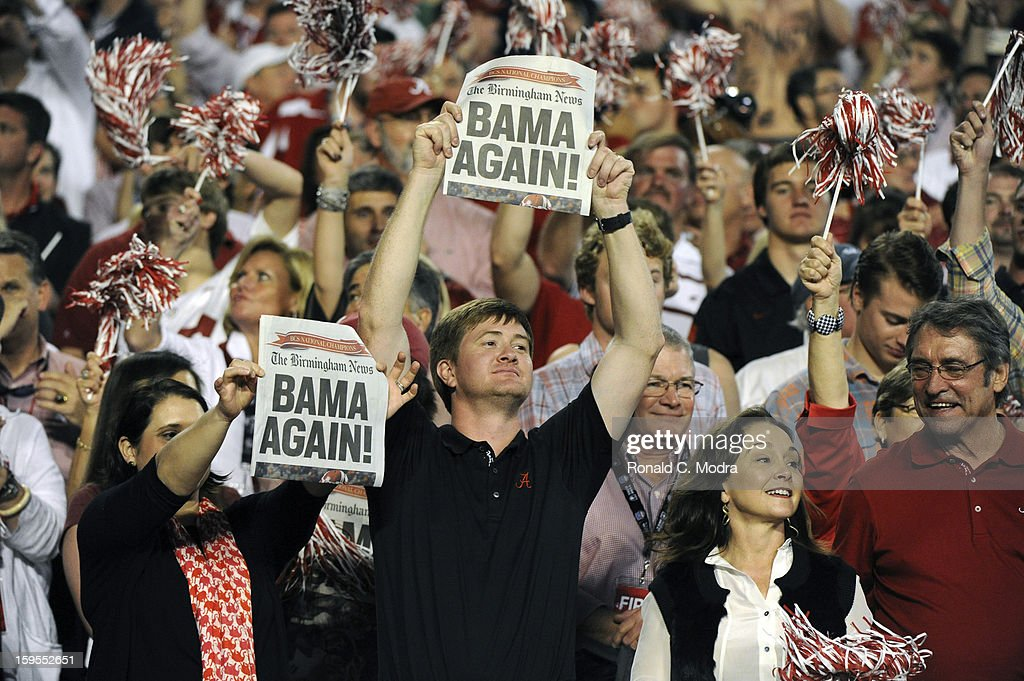 Alabama Crimson Tide fans celebrate victory against the Notre Dame Fighting Irish during the 2013 Discover BCS National Championship Game at Sun Life Stadium on January 7, 2013 in Miami Gardens, Florida.