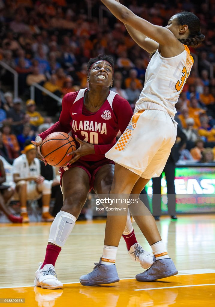Alabama Crimson Tide forward Ashley Williams (20) is guarded by Tennessee Lady Volunteers guard/forward Jaime Nared (31) during a game between the Tennessee Lady Volunteers and Alabama Crimson Tide on February 15, 2018, at Thompson-Boling Arena in Knoxville, TN.
