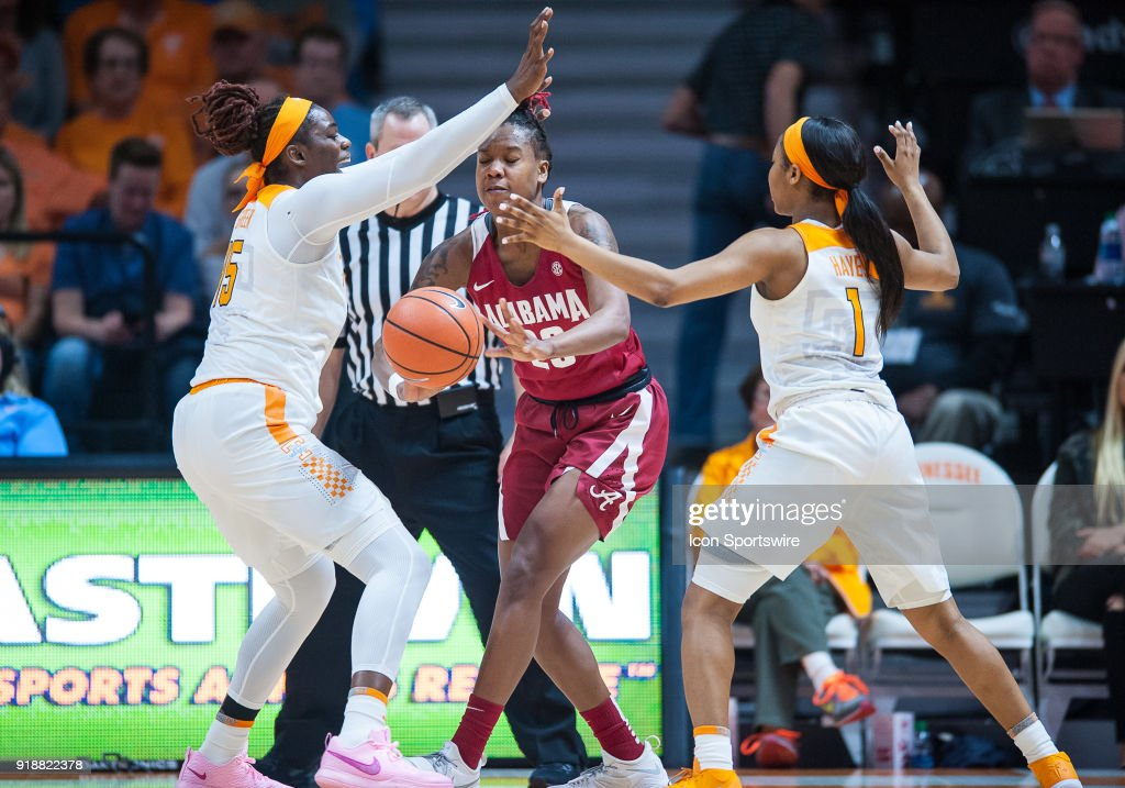 Alabama Crimson Tide guard Shaquera Wade (23) is double teamed by Tennessee Lady Volunteers forward Cheridene Green (15) and guard Anastasia Hayes (1) during a game between the Tennessee Lady Volunteers and Alabama Crimson Tide on February 15, 2018, at Thompson-Boling Arena in Knoxville, TN. Alabama defeated the Lady Vols 72-63.