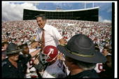 Alabama Crimson Tide head coach Gene Stallings celebrates after the Outback Bowl against the Michigan Wolverines in Tampa Florida Alabama won the...