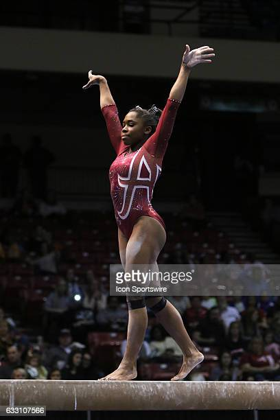Alabama Crimson Tide Kiana Winston performs on the balance beam at the Elevate the Stage Meet between the Auburn Tigers and the Alabama Crimson Tide...