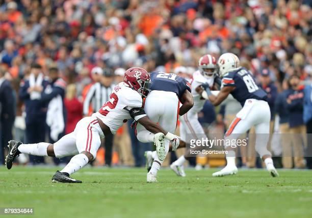 Alabama Crimson Tide linebacker Rashaan Evans tackles Auburn Tigers running back Kerryon Johnson during a football game between the Auburn Tigers and...