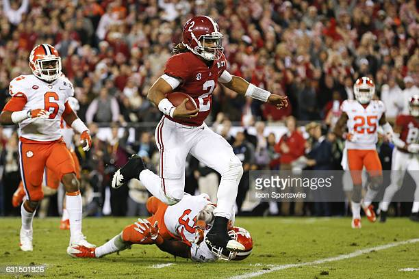 Alabama Crimson Tide quarterback Jalen Hurts breaks a tackle from Clemson Tigers linebacker Kendall Joseph on his way to the end zone for a touchdown...