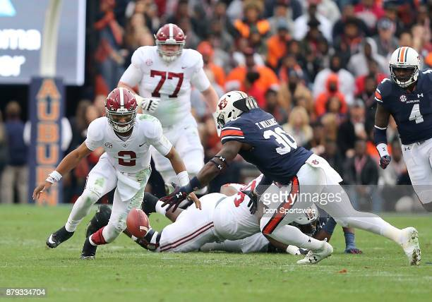 Alabama Crimson Tide quarterback Jalen Hurts fumbles the ball during a football game between the Auburn Tigers and the Alabama Crimson Tide Saturday...
