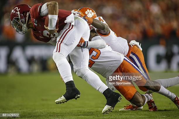 Alabama Crimson Tide quarterback Jalen Hurts is tackled by Clemson Tigers cornerback Cordrea Tankersley and Clemson Tigers wide receiver RayRay...