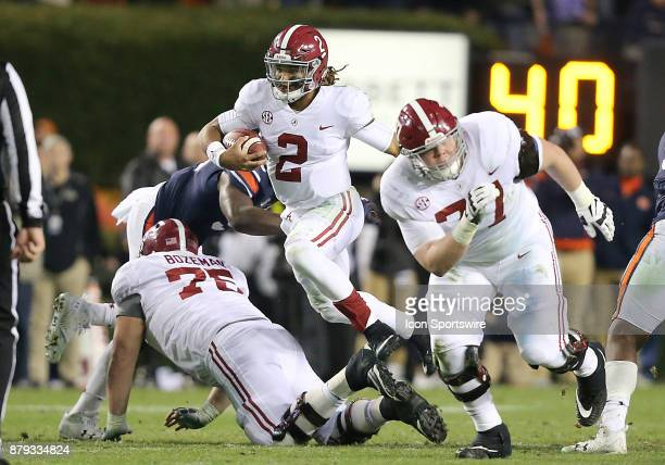 Alabama Crimson Tide quarterback Jalen Hurts leaps over offensive lineman Bradley Bozeman to pick up a first down during a football game between the...