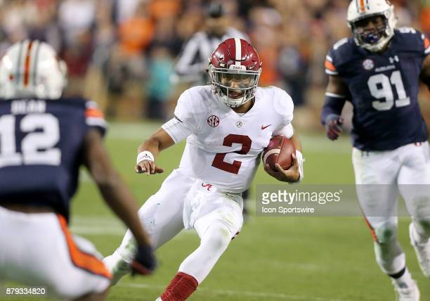 Alabama Crimson Tide quarterback Jalen Hurts runs the ball for a first down during a football game between the Auburn Tigers and the Alabama Crimson...