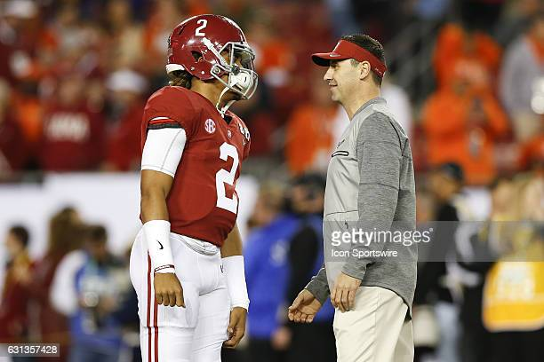 Alabama Crimson Tide quarterback Jalen Hurts talks to Alabama offensive coordinator Steve Sarkisian before the 2017 College Football National...