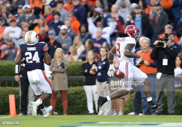 Alabama Crimson Tide running back Bo Scarbrough scores a touchdown during a football game between the Auburn Tigers and the Alabama Crimson Tide...