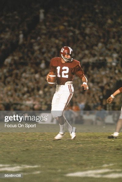 Alabama Crimson Tide's quarterback <a gi-track='captionPersonalityLinkClicked' href=/galleries/search?phrase=Joe+Namath&family=editorial&specificpeople=91230 ng-click='$event.stopPropagation()'>Joe Namath</a> #12 steps back and looks for a receiver during a game.