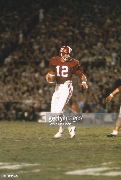 Alabama Crimson Tide's quarterback Joe Namath steps back and looks for a receiver during a game