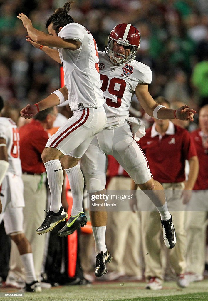 Alabama kicker Jeremy Shelley celebrates with punter Cody Mandell after Mandell punts the ball to Notre Dame's 4 yardline in the second quarter in the BCS National Championship game at Sun Life Stadium on Monday, January 7, 2013, in Miami Gardens, Florida.