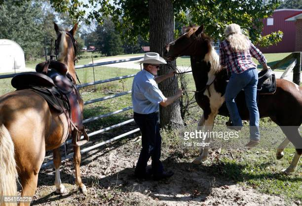 Alabama Republican US Senate candidate Roy Moore on Sassy and wife Kayla on Sundance prepare to ride home as they leave the Gallant Fire Hall after...