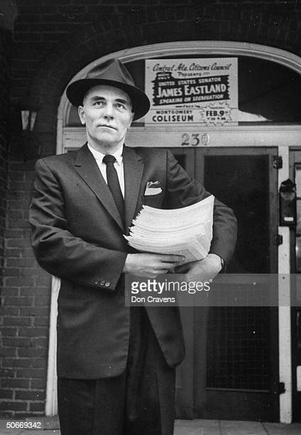 Alabama State Senator Samuel Engelhardt Jr carrying bundle of papers out of Citizens Council offices during bus boycott