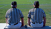 USA, Alabama, two american football referees, rear view