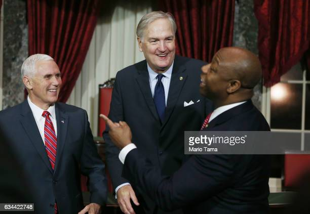 Alabama's new Sen Luther Strange laughs with US Vice President Mike Pence and Sen Tim Scott following a mock swearingin ceremony on February 9 2017...