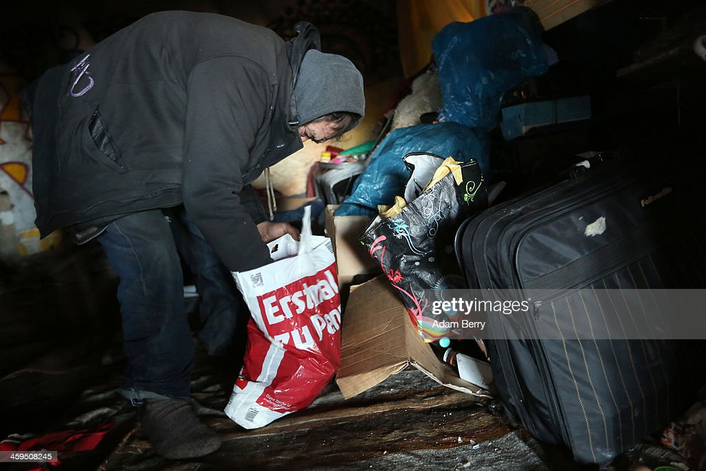 Aladdin Salim, a Roma Muslim from Bulgaria, collects his possessions inside his makeshift shelter in case of eviction from the ruins of a former ice factory known locally as the Eisfabrik on December 27, 2013 in Berlin, Germany. The future of several homeless members of the Roma community, mostly from Bulgaria, remains uncertain as officials decide whether to evict those who have taken up residence over the past two years in the decayed structure. Citizens of Romania and Bulgaria, countries which joined the European Union in 2007, will be granted full access to European job markets next year, which some critics fear may bring about 'welfare tourism,' seeing squats such as those in the Eisfabrik as a warning of what will come if the immigration is unregulated.