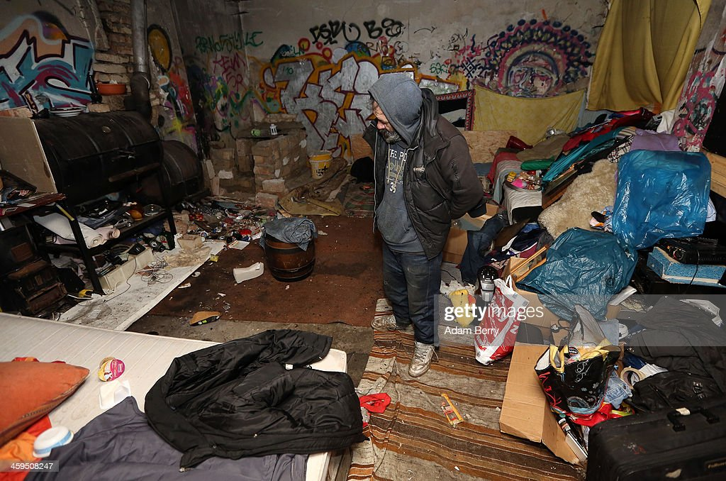 Aladdin Salim, a Roma Muslim from Bulgaria, stands between his possessions inside his makeshift shelter in case of eviction from the ruins of a former ice factory known locally as the Eisfabrik on December 27, 2013 in Berlin, Germany. The future of several homeless members of the Roma community, mostly from Bulgaria, remains uncertain as officials decide whether to evict those who have taken up residence over the past two years in the decayed structure. Citizens of Romania and Bulgaria, countries which joined the European Union in 2007, will be granted full access to European job markets next year, which some critics fear may bring about 'welfare tourism,' seeing squats such as those in the Eisfabrik as a warning of what will come if the immigration is unregulated.