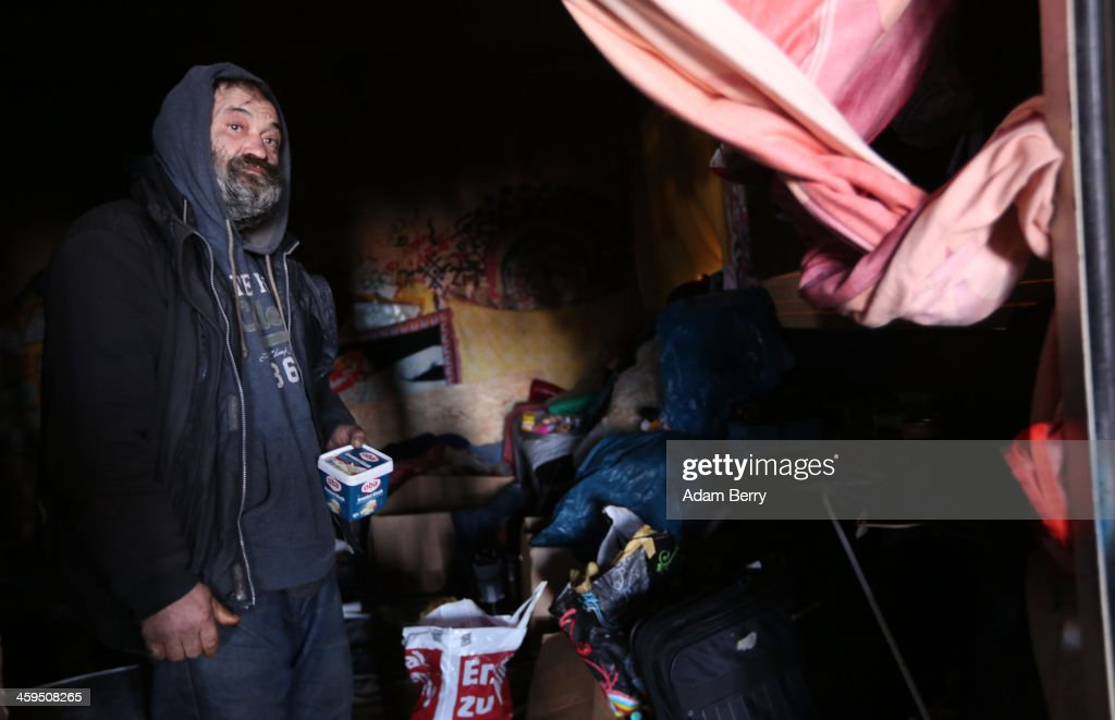Aladdin Salim, a Roma Muslim from Bulgaria, stands inside his makeshift shelter in the ruins of a former ice factory known locally as the Eisfabrik on December 27, 2013 in Berlin, Germany. The future of several homeless members of the Roma community, mostly from Bulgaria, remains uncertain as officials decide whether to evict those who have taken up residence over the past two years in the decayed structure. Citizens of Romania and Bulgaria, countries which joined the European Union in 2007, will be granted full access to European job markets next year, which some critics fear may bring about 'welfare tourism,' seeing squats such as those in the Eisfabrik as a warning of what will come if the immigration is unregulated.