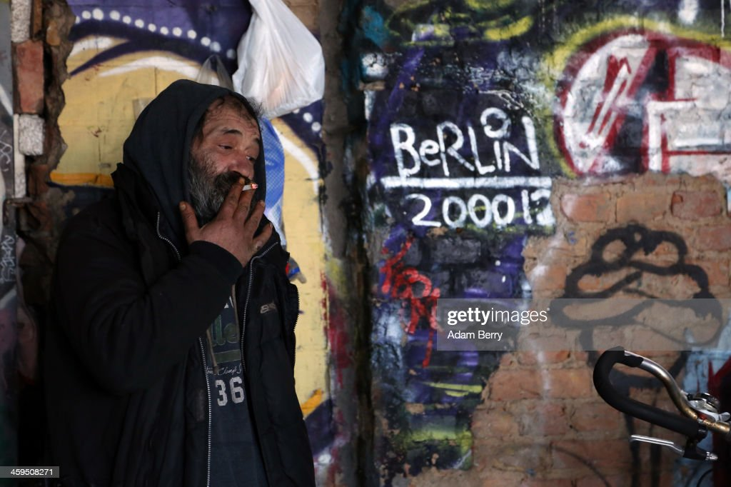Aladdin Salim, a Roma Muslim from Bulgaria, stands outside of his makeshift shelter in the ruins of a former ice factory known locally as the Eisfabrik on December 27, 2013 in Berlin, Germany. The future of several homeless members of the Roma community, mostly from Bulgaria, remains uncertain as officials decide whether to evict those who have taken up residence over the past two years in the decayed structure. Citizens of Romania and Bulgaria, countries which joined the European Union in 2007, will be granted full access to European job markets next year, which some critics fear may bring about 'welfare tourism,' seeing squats such as those in the Eisfabrik as a warning of what will come if the immigration is unregulated.