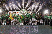 AlAhli players celebrate their championship of Saudi King Cup of Champions on the podium after defeating AlNasr in the final football match in Jeddah...