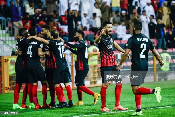 AlAhli players celebrate their goal during the AFC Champions League qualifying football match between UAE's AlAhli and Iran's Esteghlal FC at...