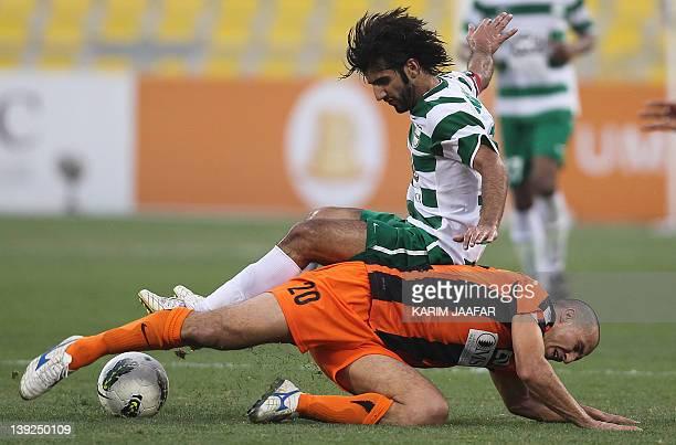 AlAhli's Abdulla Mustafa challenges Umm Salal's Jawad Ahnash during their Qatar Stars League football match in Doha on February 18 2012 AFP...