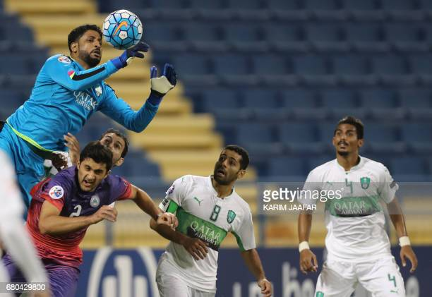 AlAhli's goalkeeper Yasser Abdullah Al Mosailem defends during an Asian Champions League football match between Iran's Zob Ahan club and Saudi...