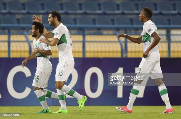 AlAhli's players celebrate during an Asian Champions League football match between Iran's Zob Ahan club and Saudi Arabia's AlAhli club at AlGharafa...