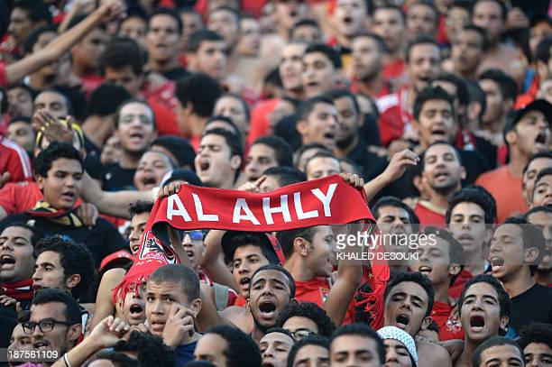 AlAhly fans cheer prior to their African Champions League second leg final Egypt's AlAhly versus South Africa's Orlando Pirates in Cairo on November...