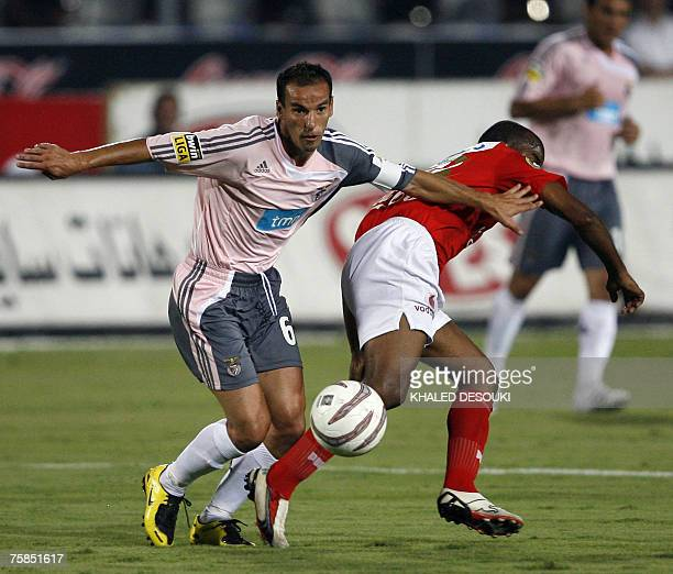 AlAhly player Angolas Flavio vies with Portugal's player Petit of Benfica club during their friendly football match in Cairo 29 July 2007 AFP...