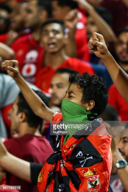 AlAhly supporters cheer for their team during the CAF Champions League final football match between AlAhly and Wydad Casablanca at the Borg El Arab...