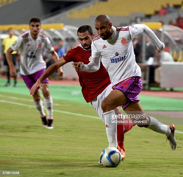AlAhly's Ahmed Fathi marks Wydad's Ismail Haddad during their CAF Champions League group A stage football match between Egypt's AlAhly and Morocco's...