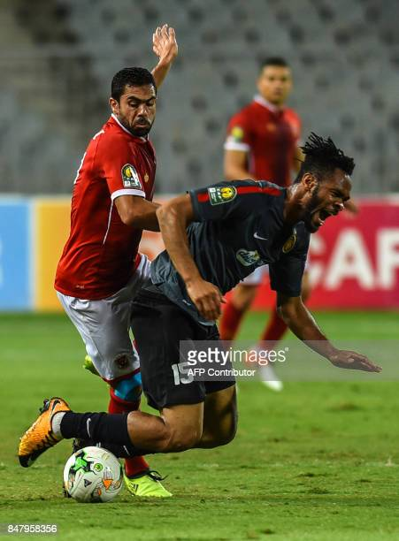 AlAhly's Ahmed Fathi vies for the ball with Esperance of Tunis' Ahmed Youssef during the CAF Champions League quarterfinal firstleg football match...
