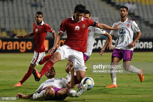 AlAhly's Amr Gamal is tackled by Wydad's Amine Atouchi during their CAF Champions League group A stage football match between Egypt's AlAhly and...