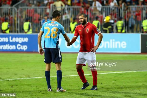 AlAhly's Emad Meteb and Wydad Casablanca defender Abdelatif Noussir during the CAF Champions League final football match between AlAhly and Wydad...