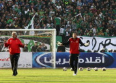 AlAhly's goalkeeper Sherif Ekramy gestures during a warmup before his team's football match against AlMasry in the Egyptian coastal city of Port Said...