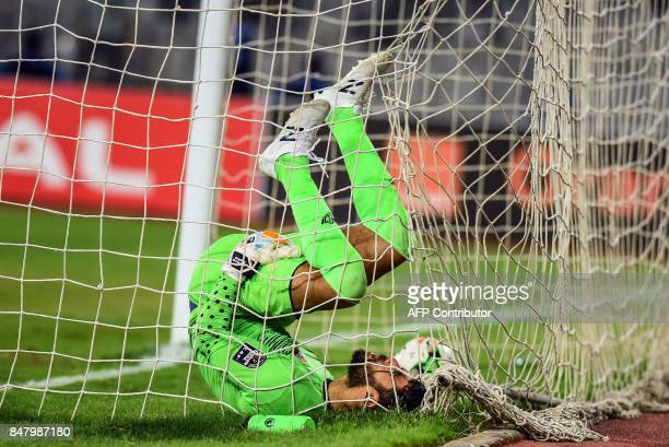 AlAhly's goalkeeper Sherif Ekramy reacts after attempting to save the ball during the CAF Champions League quarterfinal firstleg football match...